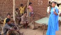 Staff member Pomi speaks to Village Elders